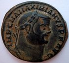 A ROMAN BRONZE FOLLIS OF MAXIMIAN