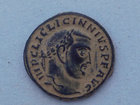A ROMAN BRONZE FOLLIS OF EMPEROR LICINIUS I