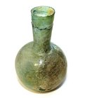 AN EASTERN MEDITERRANEAN GREEN GLASS FLASK